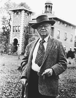 Russell Kirk in hat in front of Piety Hill