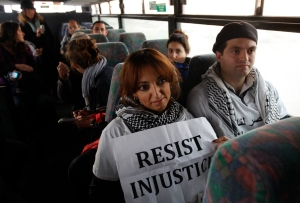 Two Palestinian activists sit inside as