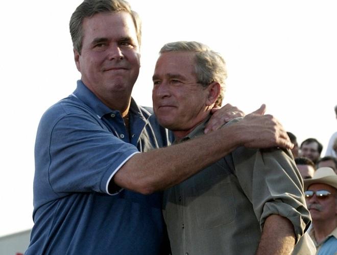 US President George W. Bush (R) is embra
