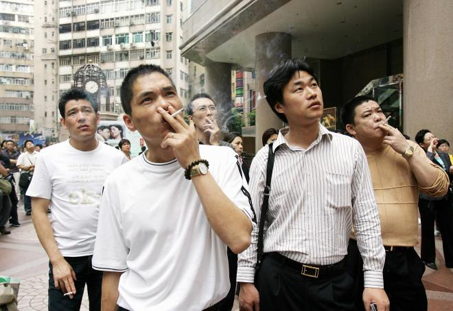 A group of men enjoy a smoke as they joi