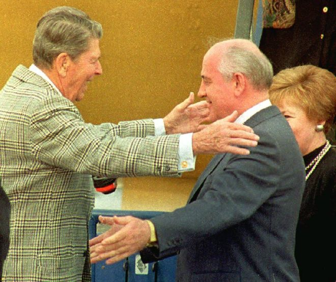 Former U.S. President Ronald Reagan (L) greets for