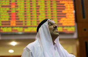An Emirati trader looks at the prices of