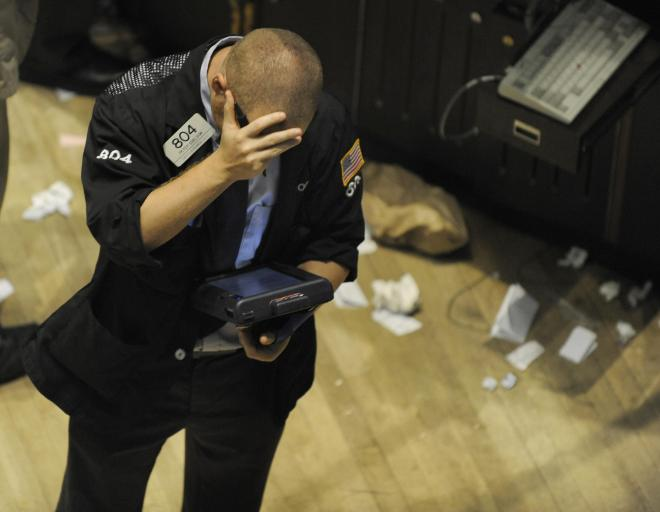 A trader reacts on the floor of the New