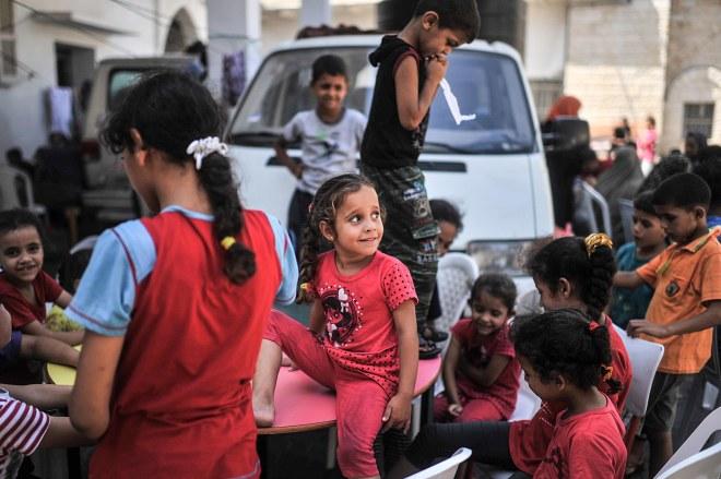 Palestinians taking shelter in an UN school in Gaza