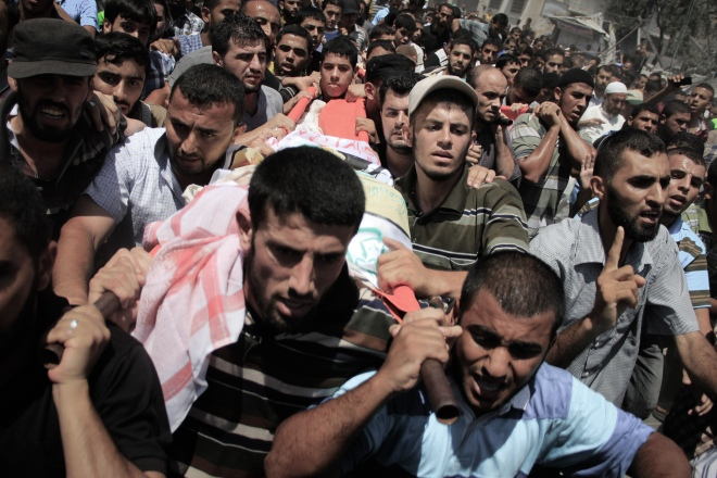 Palestinians carry the body of Mohammed Abu Shammala, one of