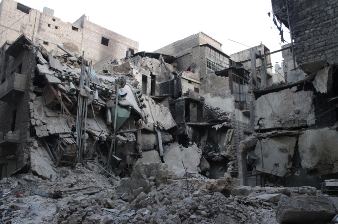 A view of a damaged buildings after barrel bomb was dropped