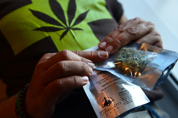 WASHINGTON, DC - JULY 29:   A man purchases medical marijuana,