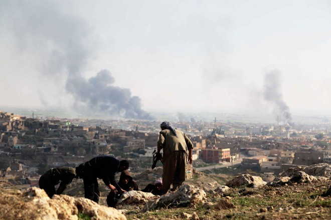 Clashes between ISIL and Peshmerga forces in Sinjar